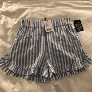 Swimton ruffles striped cotton shorts